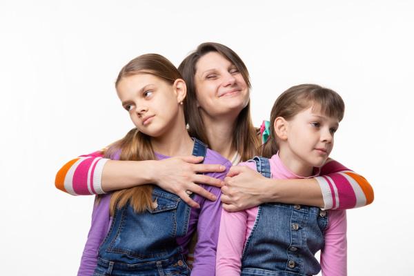 mom happily hugs children children