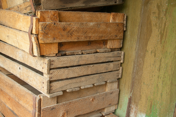 a stack of old wooden boxes