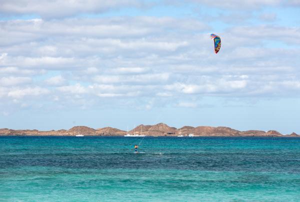 kitesurfer surfing on a flat