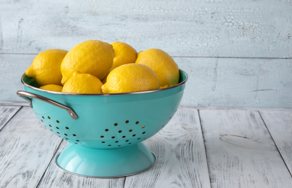 fresh lemons in the colander