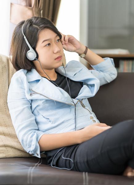 woman short hair listening music in