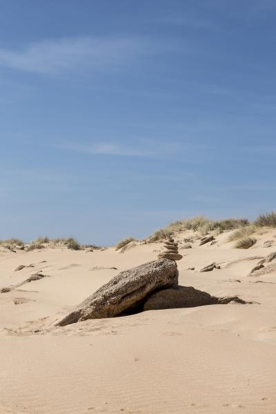 stack of pebble on sandy beach