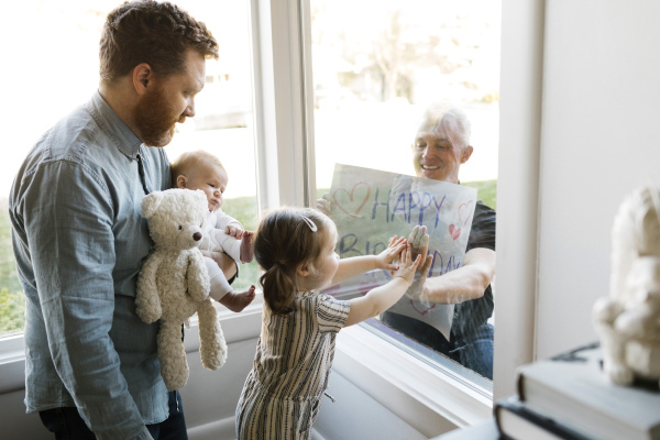 grandfather visiting family with grandchildren