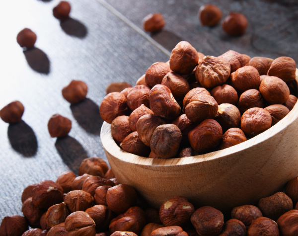 bowl with hazelnuts on wooden table