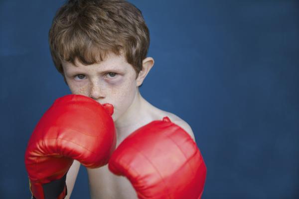 portrait tough boy with black eye