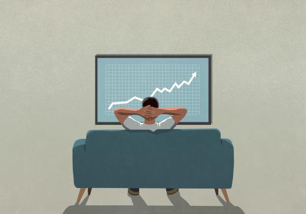 man on sofa watching rising stock
