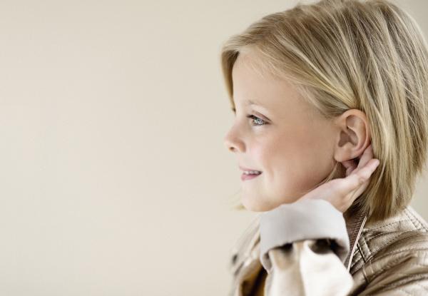 profile portrait smiling blonde girl looking