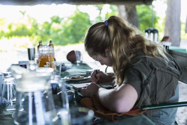 thirteen year old girl writing in