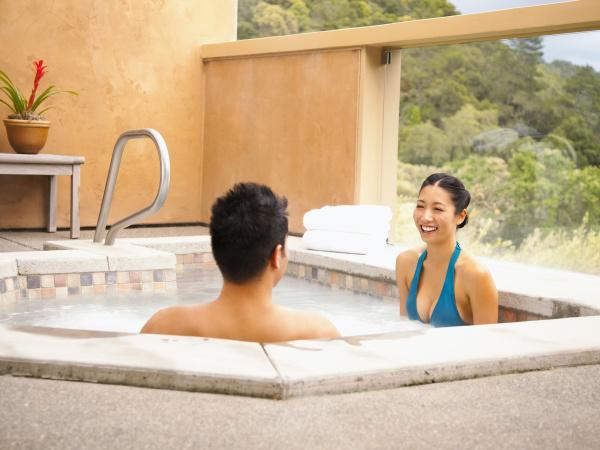 asian couple enjoying hot tub