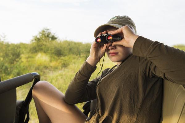 thirteen year old girl with binoculars