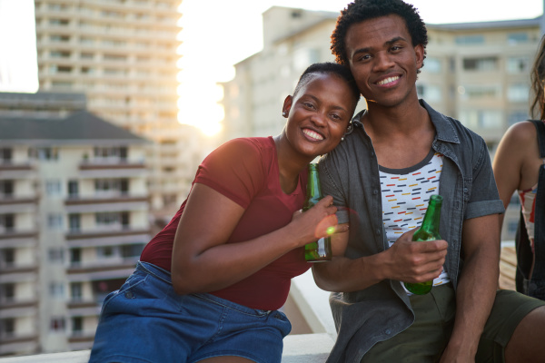 portrait happy young couple drinking beer