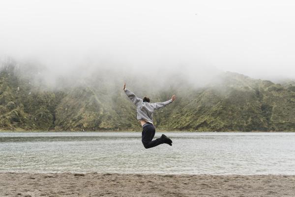 full length of man jumping in