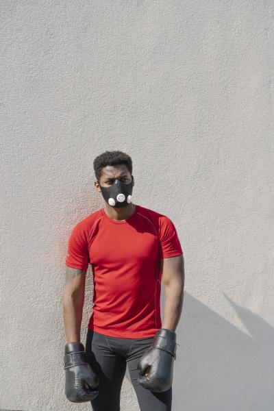 portrait of a sportsman wearing face