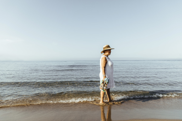 senior woman wading in the sea