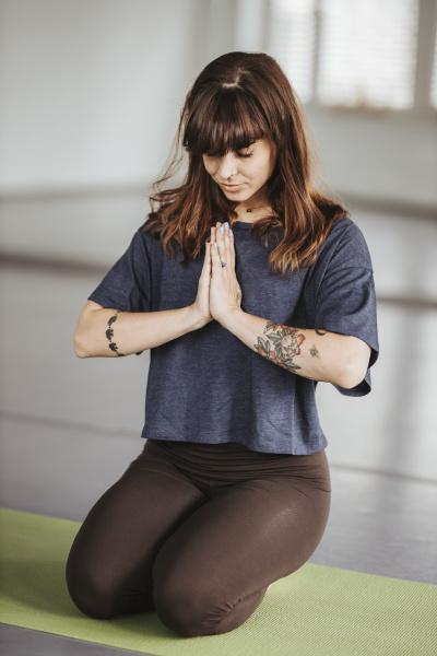 ballerina meditating in prayer position on