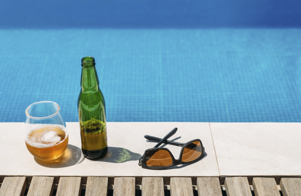 sunglasses and open beer left at