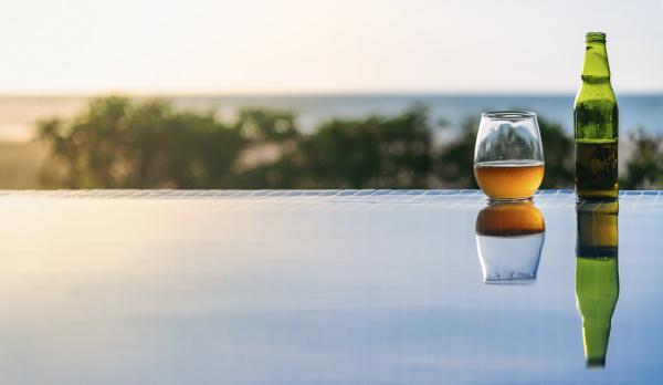 open beer left at edge of