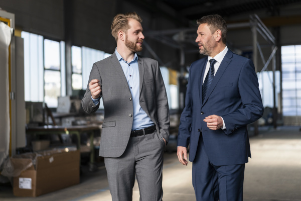 two, businessmen, walking, and, talking, in - 28744967