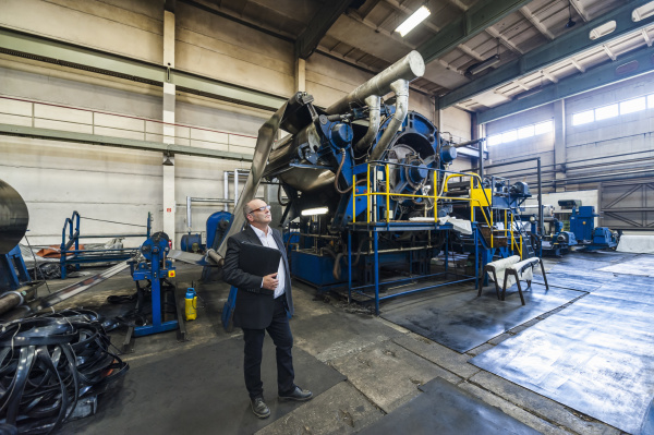 senior businessman in a rubber processing