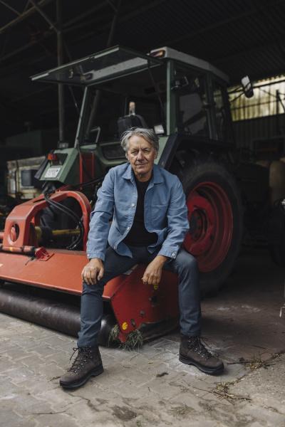 senior man on a farm sitting