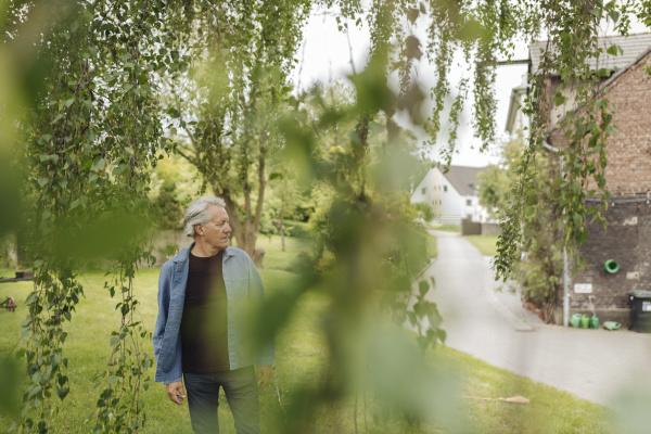 senior man standing in a rural