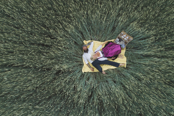 aerial view of mature couple lying