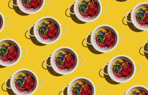 pattern of colanders with colorful pasta