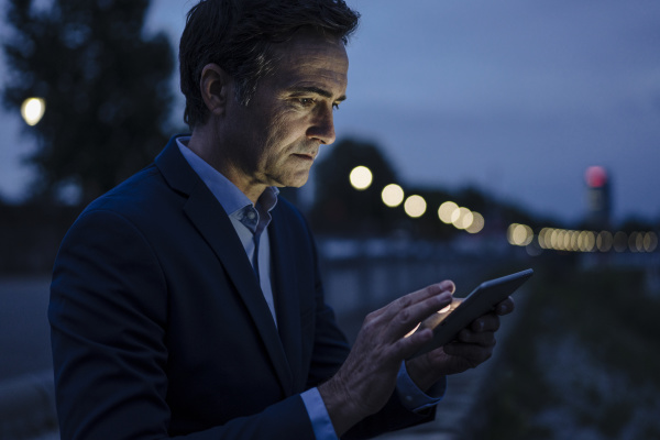 mature businessman using tablet on a