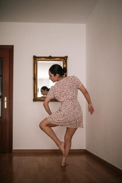 ballerina performing dance at home