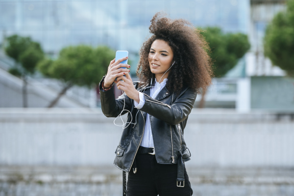 young afro woman taking selfie from
