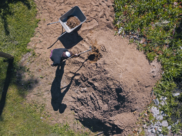 aerial view of man loading sand