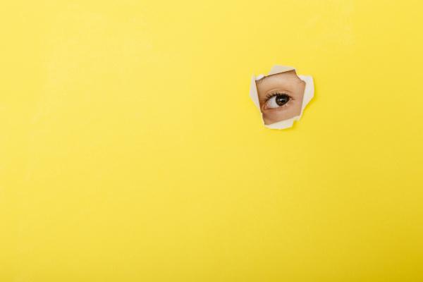 close up of boy peeking through
