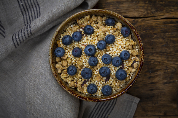bowl of granola with blueberries and