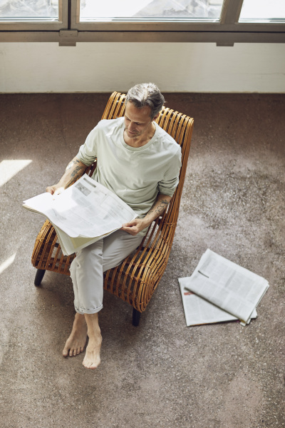 senior man sitting on chair in