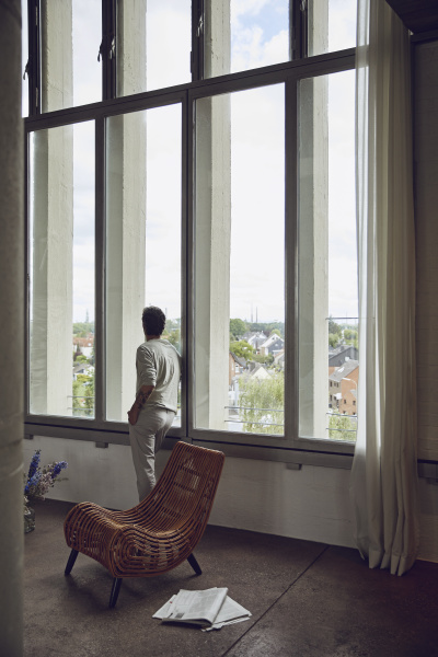 senior man looking out of window