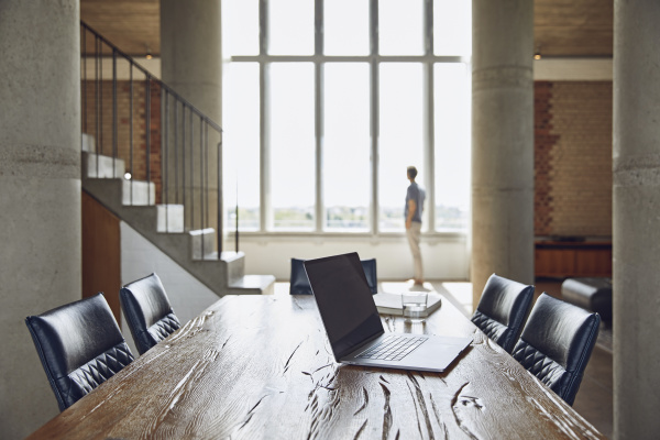 laptop on wooden table in a