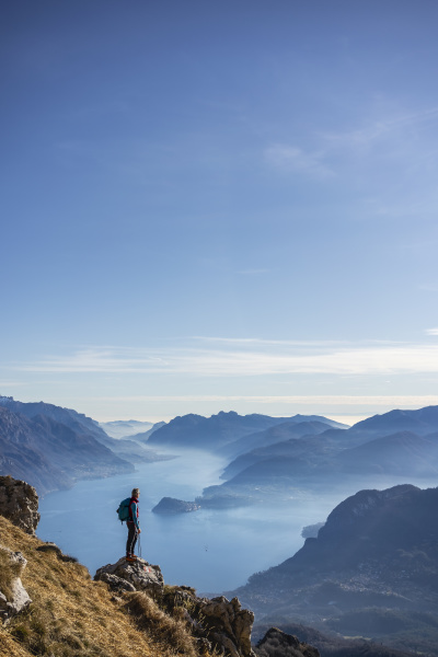 hiker standing on mountain looking