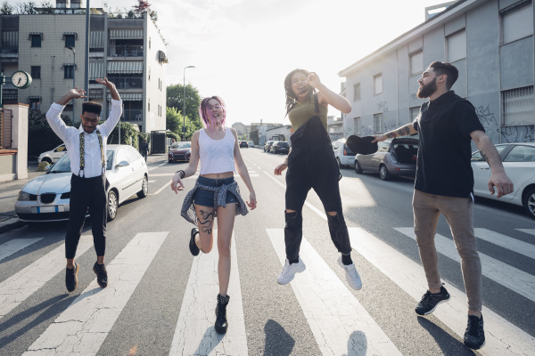 group of carefree friends jumping on