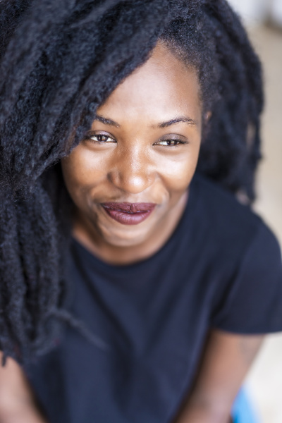 portrait of young woman with dreadlocks