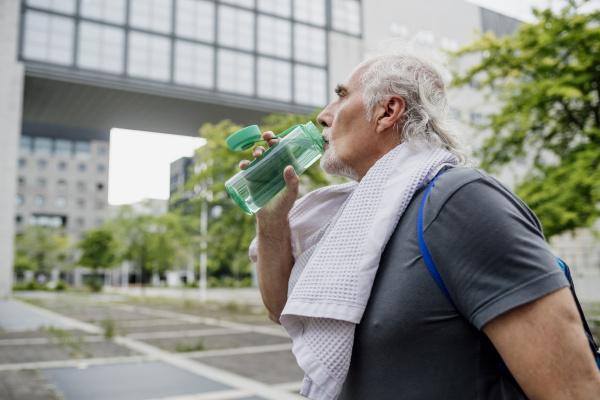 close up of senior man drinking
