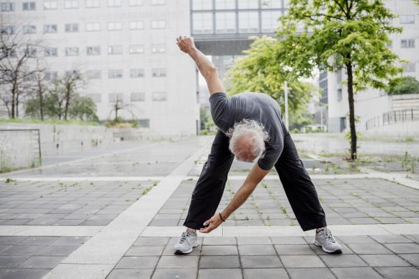 senior man exercising while standing on