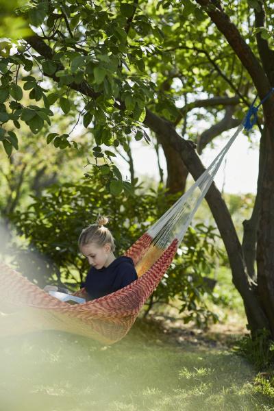 girl in hammock reading a book