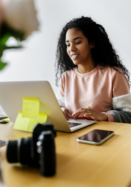 young woman working from home using