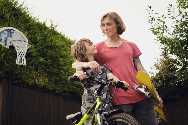 father and son with bicycle and