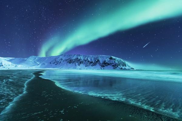 northern lights above the beach berlevag