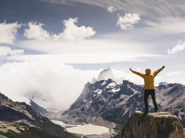 man with arms outstretched looking at