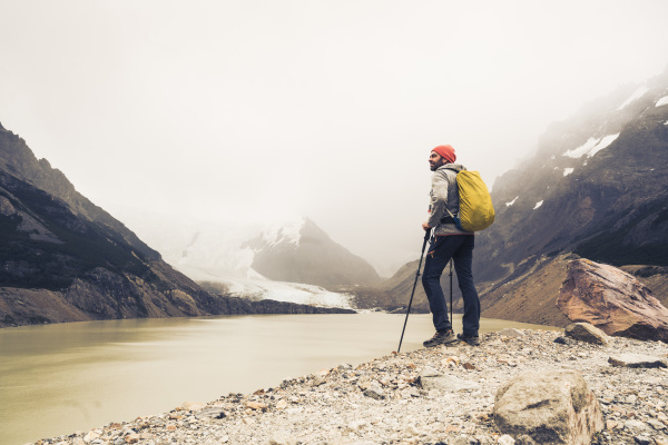 man with hiking poles standing by