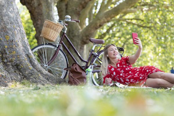 woman taking selfie through smart phone