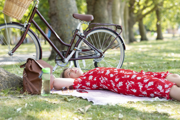 relaxed woman lying at public park
