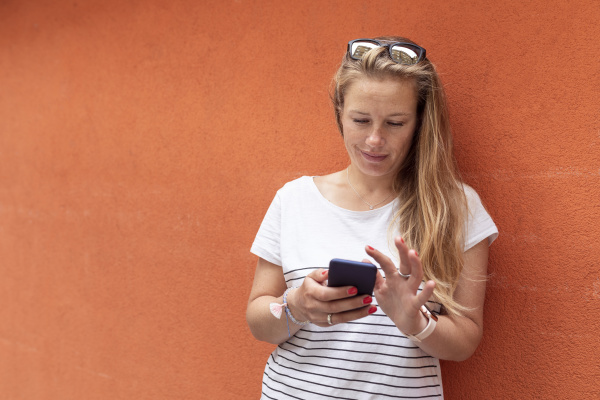 mid adult woman using smart phone